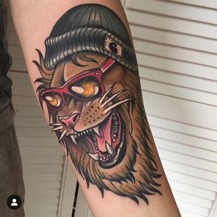 Tatouage old school Tête de Lion sur avant bras