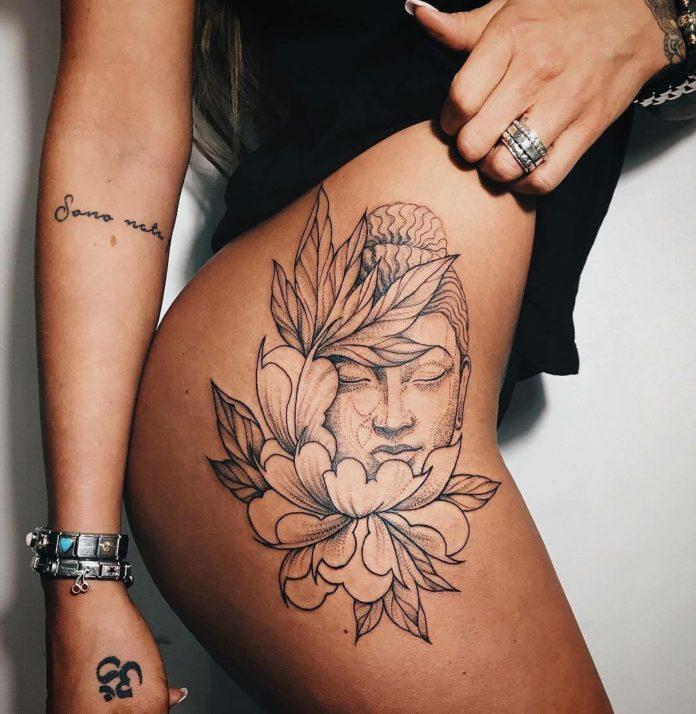tatouage de femme à la cuisse