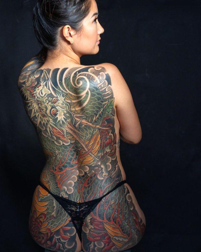 51 new - 100 Magnifiques Tatouages Dos pour Femme