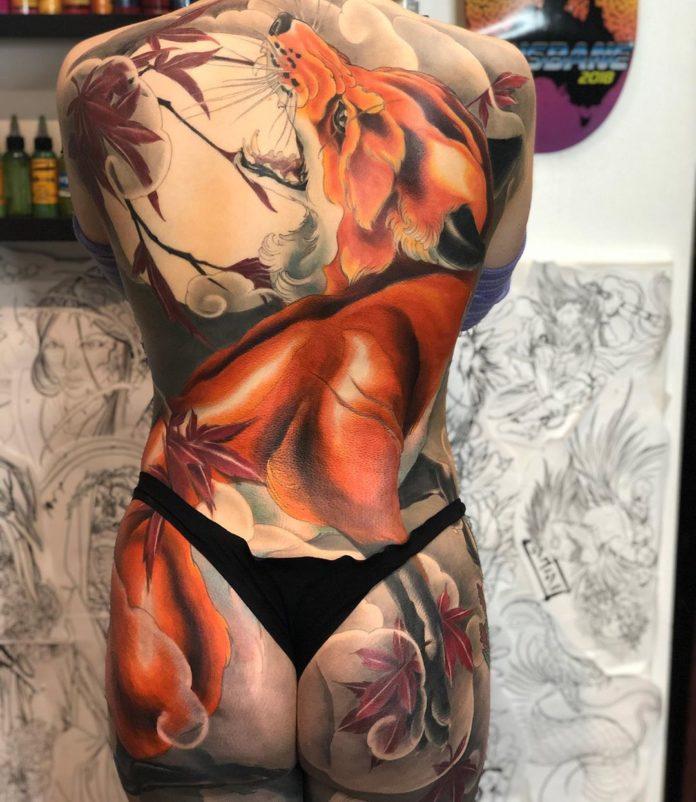79 new - 100 Magnifiques Tatouages Dos pour Femme